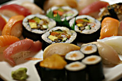 Sushi. Is vinegar rice, topped with other ingredients, such as fish.The common ingredient across all the different kinds of  is  rice. The variety in  arises stock photo