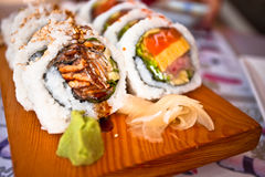 Sushi. Presented on a wooden platter Royalty Free Stock Photography