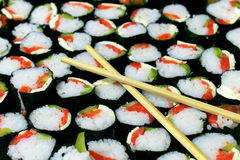 Sushi. With red fish and green cucumber with chinese stick Stock Image