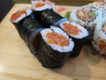 Sushi. Salmon sushi rolls on wooden plate Royalty Free Stock Photography