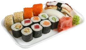 Sushi. Red caviar, sushi and wasabi on a white dish done royalty free stock photos