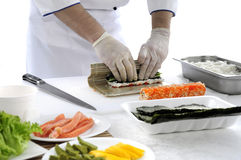 Sushi. Chef prepares Japanese food - sushi. On the table, the ingredients for sushi stock photo