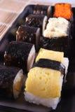 Sushi. Japanese sushi on a black plate Stock Image