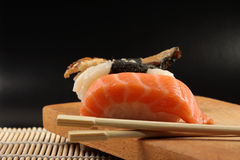 Sushi. On the black background Royalty Free Stock Photos