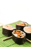 Sushi. On green mat - narrow focus Stock Photography