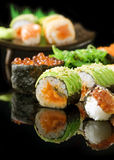 Sushi. Different Sushi and Rolls over Black Background royalty free stock images