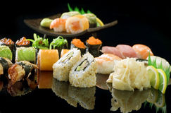 Sushi. Different Sushi and Rolls over Black Background stock photo