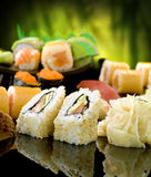 Sushi. Different Sushi and Rolls over Black Background stock image