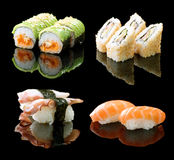 Sushi. Set of Different Sushi and Rolls over Black Background royalty free stock photo