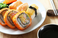 Sushi. Classic japanese meal - sushi with differend kinds of fresh fish: salmon, egg Stock Images