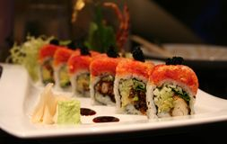 Sushi. Beautiful presentation of soft-shell crab, spicy tuna, and black tobiko Stock Image