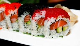 Sushi. Japanese sushi on a white plate Royalty Free Stock Image