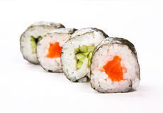 Sushi. Four rolls of sushi on white stock image