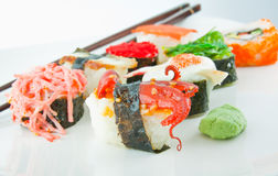 Sushi. On white plate with chopsticks Royalty Free Stock Photo