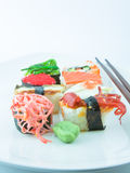 Sushi. On white plate with chopsticks Royalty Free Stock Image
