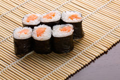 Sushi. Land on a bamboo rug Stock Image