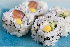 Sushi. A close-up of four roll of sushi on a blue plate Stock Photo