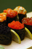 Sushi. With caviar and sliced lemons Royalty Free Stock Photography