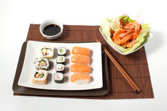 Sushi. Composition sushi and shrimp and soy on a white background Stock Photo