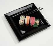 Sushi. On plate with chopsticks Royalty Free Stock Photos