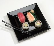 Sushi. On plate with chopsticks Royalty Free Stock Images