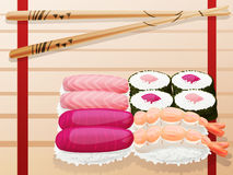 Sushi. Chopsticks and sushi on wooden cutting board Stock Photography