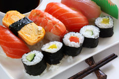 Sushi. Dish of assorted sushi, with soy sauce and chopsticks Royalty Free Stock Photo