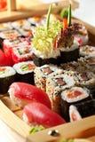 Sushi. Japanese Cuisine - Sushi on a Wooden Ship Stock Photography