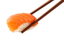 Sushi. Salmon sushi in chopsticks on white background stock photo