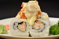 Sushi. Rolls topped with dynamite sauce Stock Photo