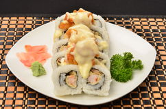 Sushi. Rolls topped with dynamite sauce Stock Images