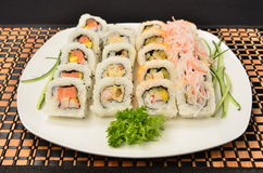 Sushi. Combination of Japanese food Sushi with a piece of chicken as a companion Stock Image