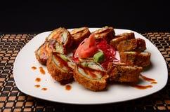 Sushi. Tempura Rolls decorated with eel sauce, Sushi food Stock Photos