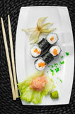 Sushi. Japanese healthy food-sushi on a white plate Royalty Free Stock Images