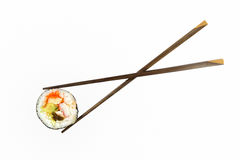 Sushi. Isolated sushi roll with chopsticks Royalty Free Stock Photos