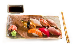 Sushi. A plate of nigiri sushi on white background Royalty Free Stock Photos