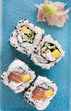 Sushi. A close-up of four roll of sushi on a blue plate Royalty Free Stock Image