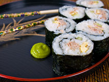Sushi. On a Japanese plate with chopsticks stock image