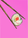 Sushi. And chopsticks  on pink Stock Images