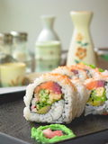 Sushi. On the black plate - white background Stock Photography