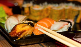 Sushi. A Japanese dish consisting of small cakes of cold rice with a topping esp of raw fish Stock Photos