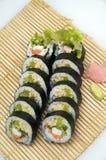 Sushi. On the black plate - white background Stock Photo