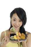 Sushi. Pretty smiling woman with sushi Royalty Free Stock Photo