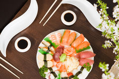 Sushi. Table with a plate full of assorted sushi royalty free stock photos