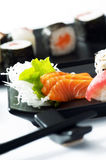 Sushi. And sashimi served on black plate Royalty Free Stock Photos