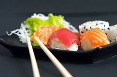 Sushi. And sashimi served on black plate Stock Photo