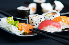 Sushi. And sashimi served on black plate Stock Image