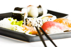 Sushi. Served on black plate Stock Images
