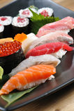 Sushi. Japanese sushi on a black plate royalty free stock image