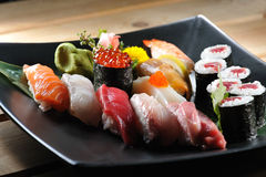 Sushi. Japanese sushi on a black plate stock photo